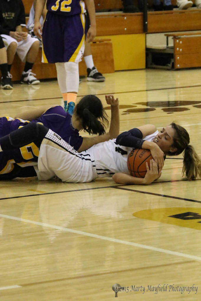 Brianna Pais wrestles the ball away from Heaven Chavez Saturday night in a tough game with the Tucumcari Lady Rattlers