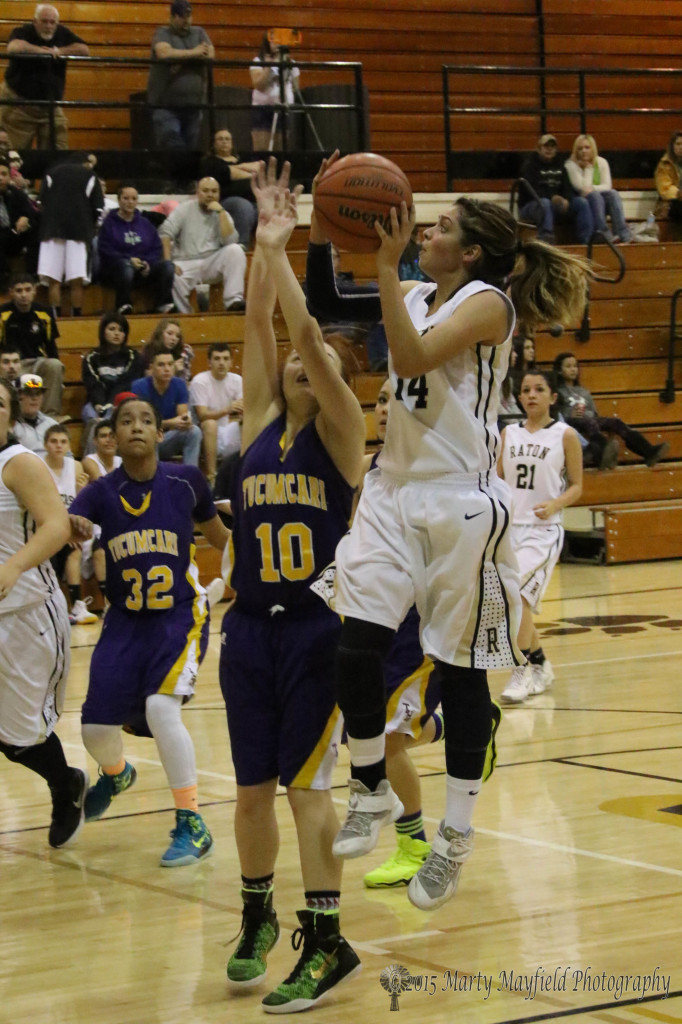Brianna Pais goes for the basket against Alyssa Martinez(10) on her way to a high point honor with nine points Saturday evening