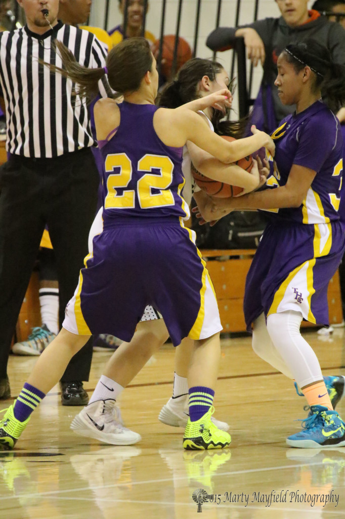 Heavan Chavez (22) and Kalani French (32) double team Sophia Maddelini. The Lady tigers often found themselves double teamed during the first district game of the season for Raton.