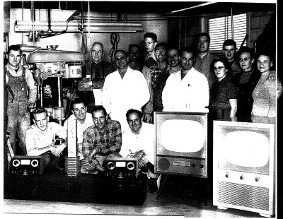 Employees of ARF Products, Inc. , circa 1955, with early televisions, the Ratonia and the Pikes Peak Left to right, front row:  John Perkovich, Bill Groves, Frank Gabriele, John Gabriele, Ralph McCreight Left to right, second row:  Waldo Jarmin, John Owerko, Charles Gasperetti, Howard Jarmin, Basil Herndon, Wally Clark, Dave Joseph (Plant Manager), Cheto Calderon, Lois Grove, Gilbert SanRoman, Lorraine Schuster, Gertrude Kemp