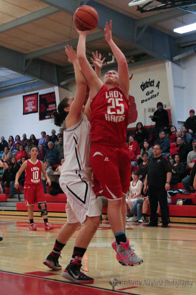 Jessica Pittman goes for the lay-up as Alicia Arias attempts the block during the District 5A championship game.