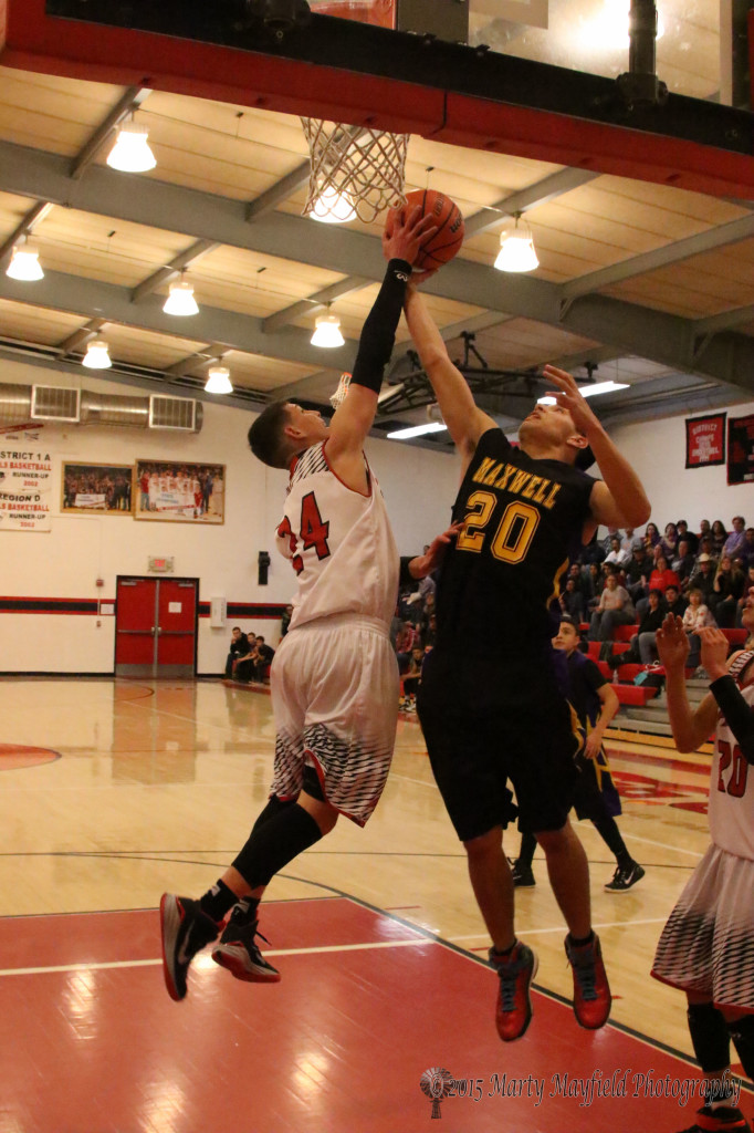 Isaiah Garcia gets a hand on the ball as Devon Cruz goes up with the shot.