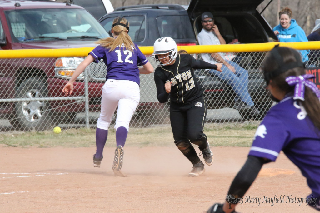 Andie Ortega heads for home after a wild throw to third base during the game with Santa Rosa Monday afternoon