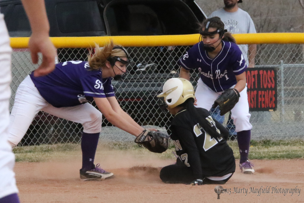 Natasha Ortega slides safe into third during the game with Santa Rosa Monday afternoon