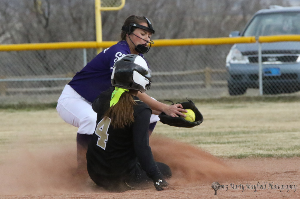 Montana Trujillo slides safe into second as the ball arrives a fraction to late.