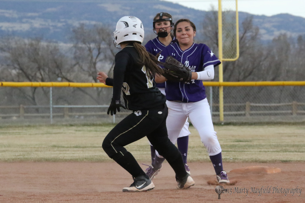 Andie Ortega gets caught in the pickle and pulls off an escape as she out runs a throw and makes it to second base.
