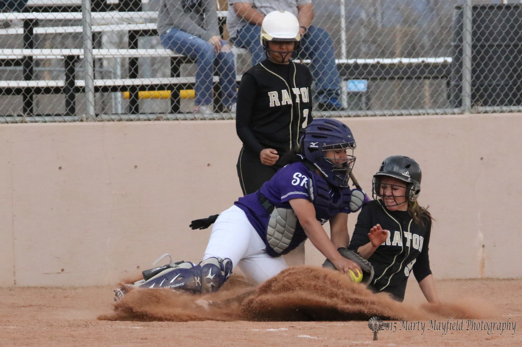 Mariah Encinias is out at home as she tried to slide in under the ball during the game with Santa Rosa Monday afternoon.