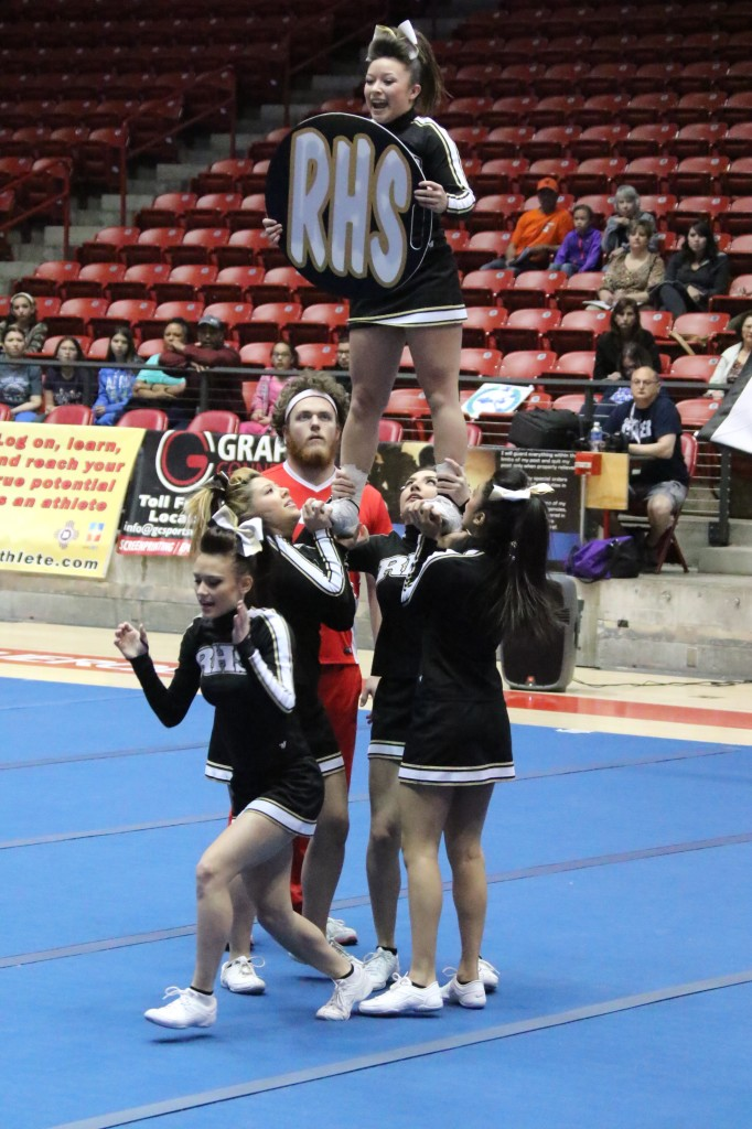 Brianna Marquez shows the sign as Kailie Village Center prepares her tumble.