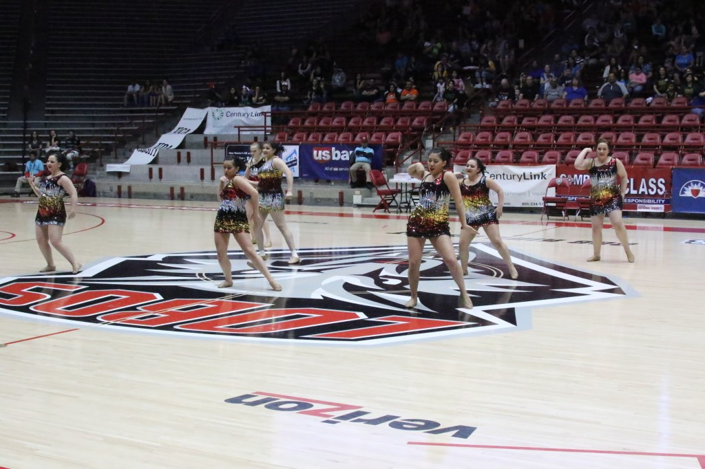 Led by seniors Heather Segura and Sabrina Valdez is the Tiger Cats dance team performing in the Pit during the 2015 State Spirit competitom