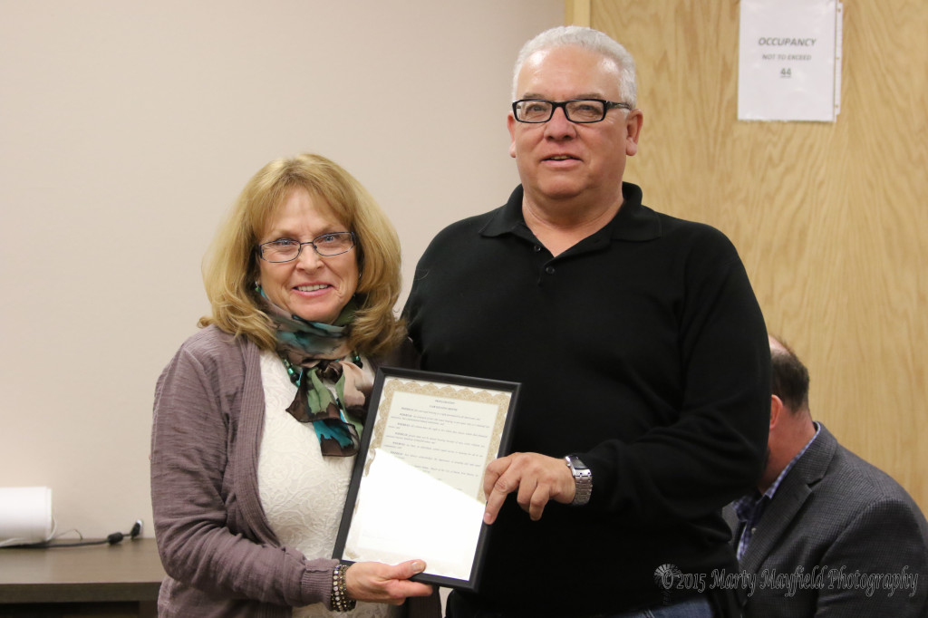 Terry Baca accepted the proclamation for Fair Housing Month from Commissioner Linde Schuster.