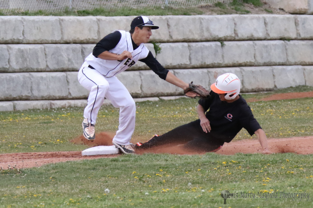 Clayton's Koy Geary slides safe into third just under the tag of Brandon Luksich