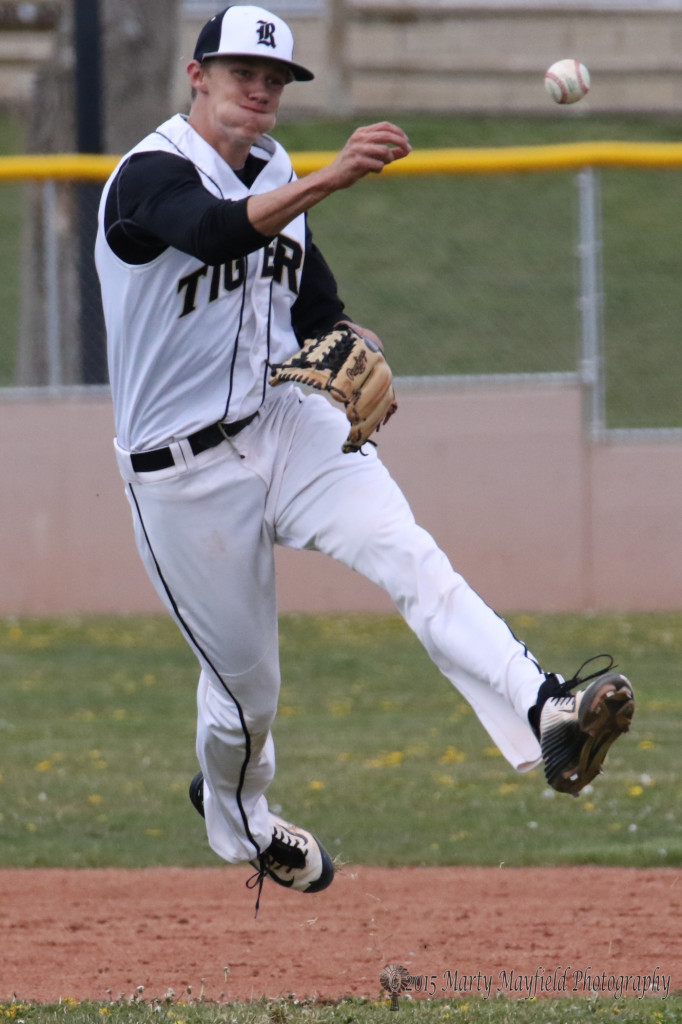 Senior Ethan Washburn makes the throw to first during game one of a double header with Clayton