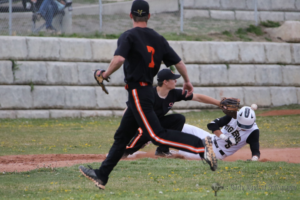 Dante Mileta slides safe into third, or does it count as an out if the ball hits you on the way in.
