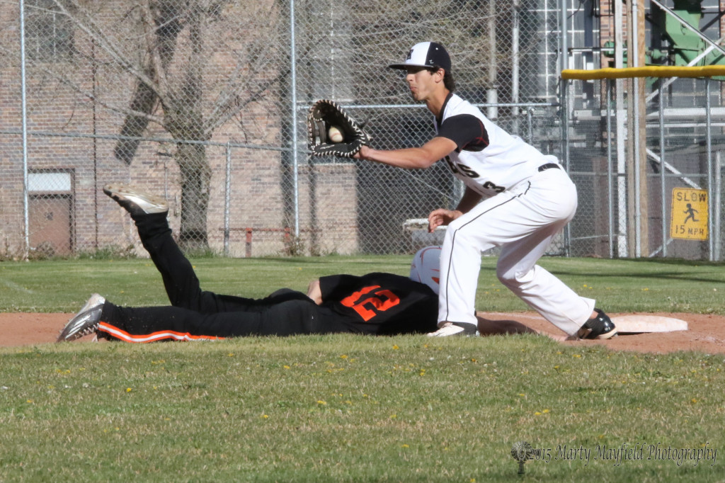 Koby Montoya just makes it back to first as the ball arrives in Christian Granada's glove