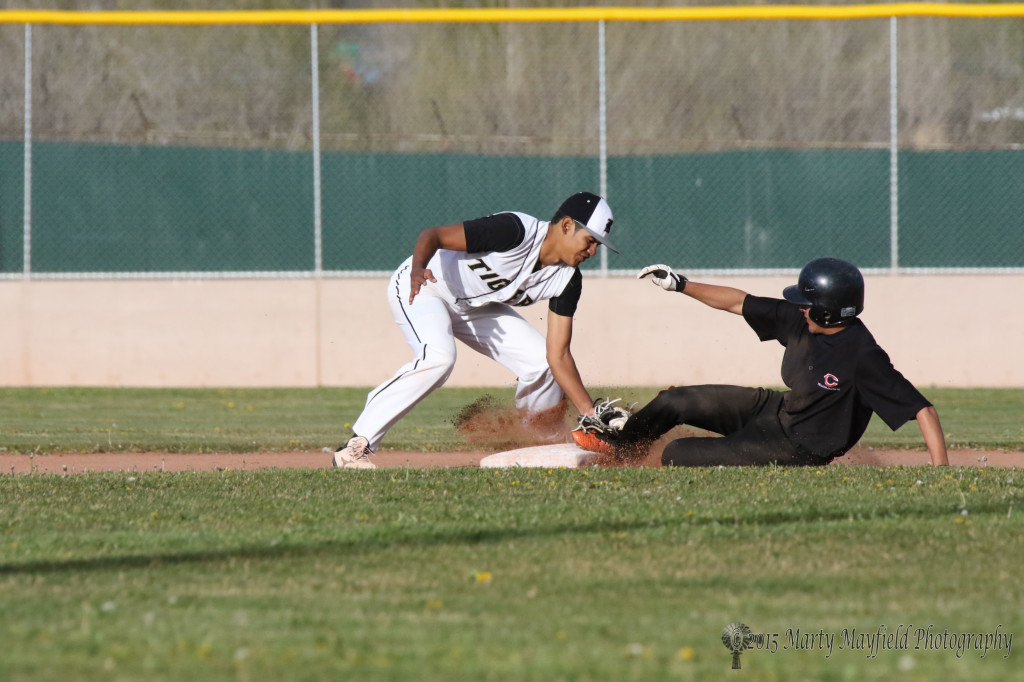 Antonio Lucero slides into second before Jonathan Cabrieles can make the tag.