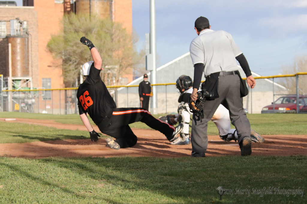 Clifton MacCurry slides home but Raton catcher Dante Mileta looses the ball in the hustle