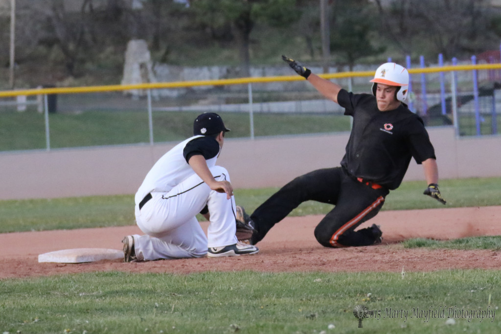 Seth Martinez steals third just as the ball flies by Brandon Luksich's glove and on into left field
