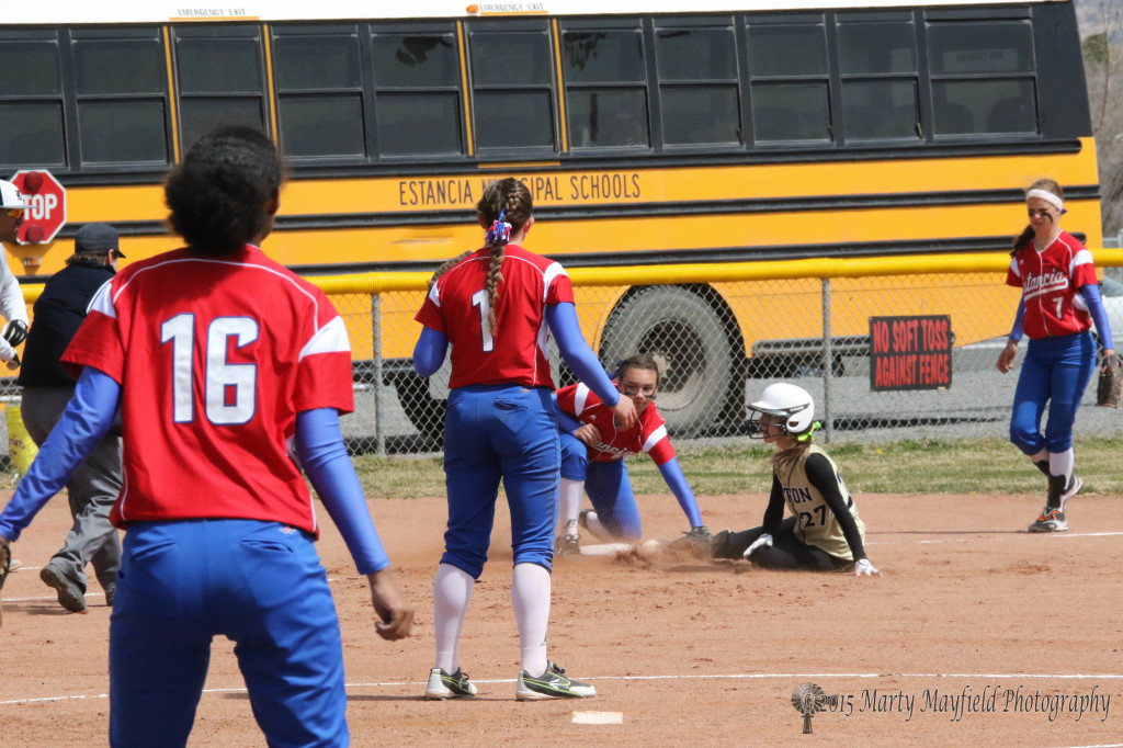 Camryn Mileta looks at the umpire after sliding into third base, the ruling was safe as she hit the bag just before the tag Saturday against Estancia
