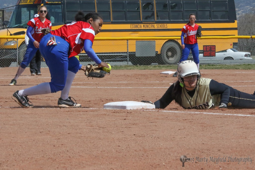 Tina Jaramillo returns to 1st base ahead of the throw from the catcher.