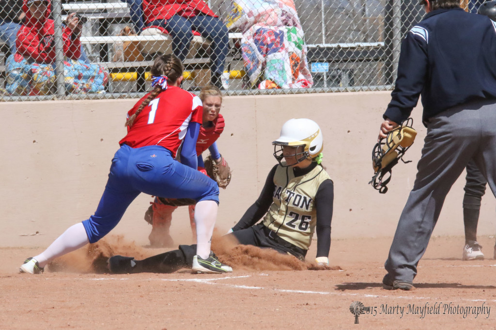 Camryn Stoeker slides safe into home plate as the Lady Tigers keep a scoring rally going in the fourth inning