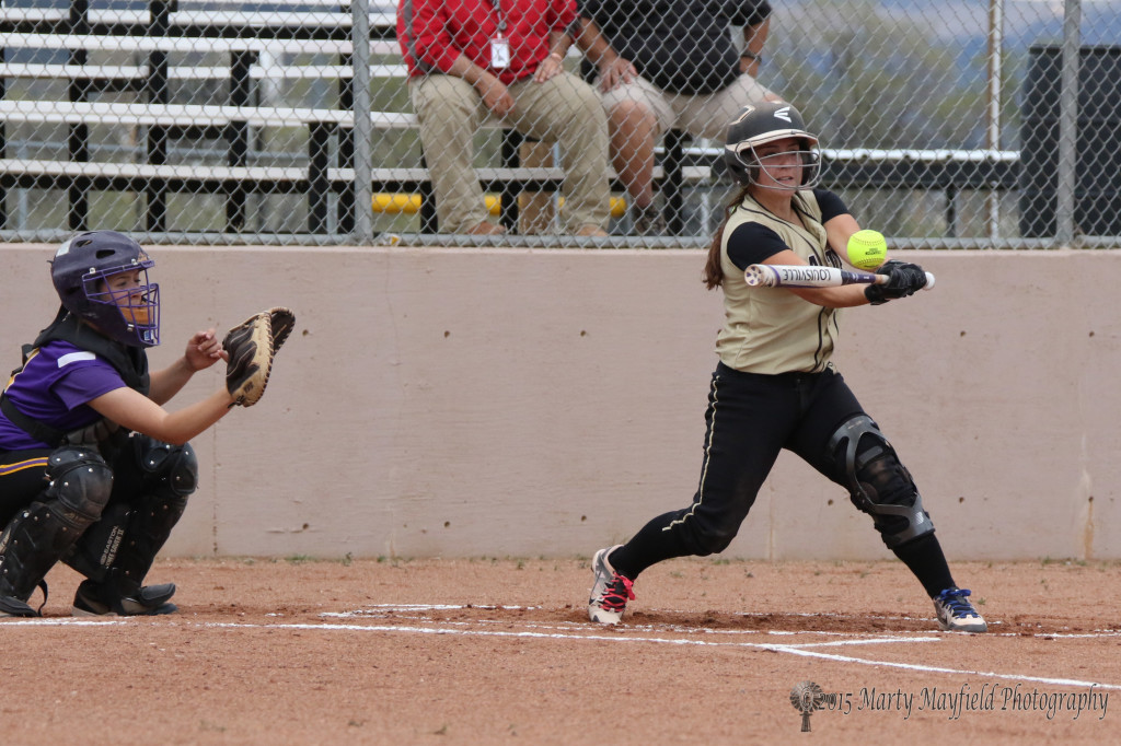 Caydence Sisneros sends this one sailing during the game with Tucumcari Thursday afternoon at Jim Wade Field