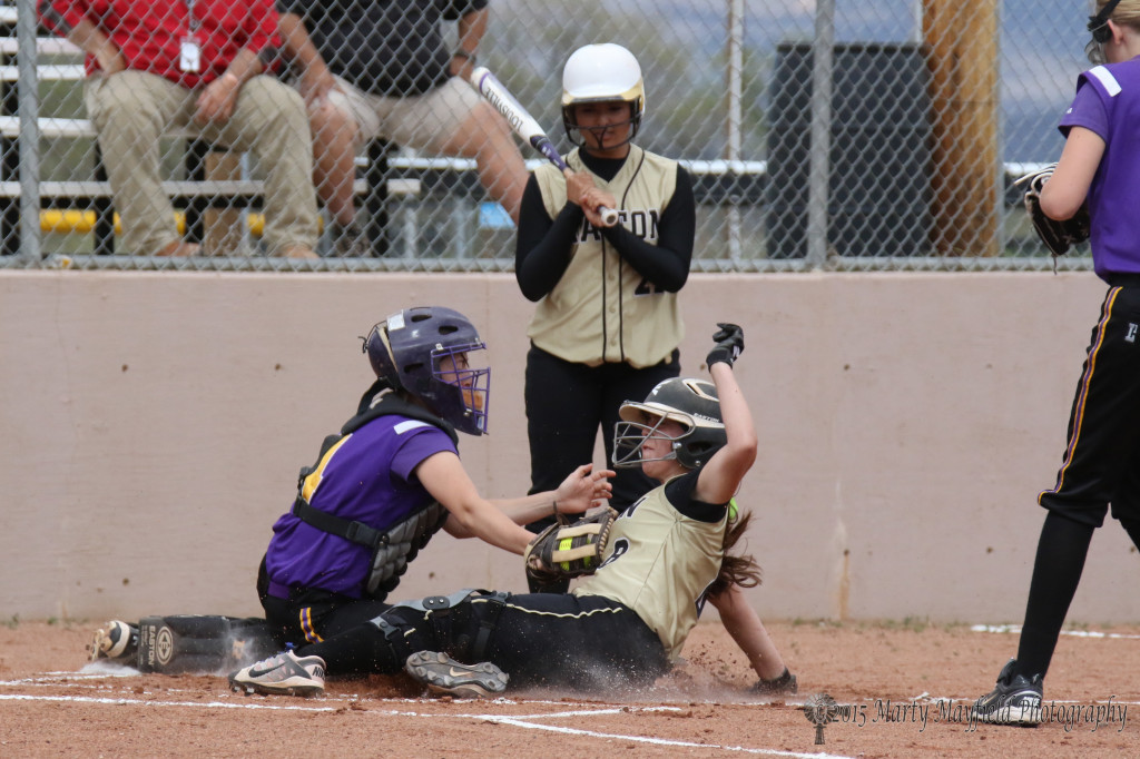 Caydence Slides home safe just outside the reach of the Tucumcari catcher Emma Garcia