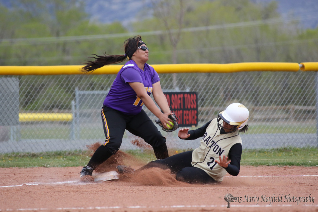 Natausha Archuleta slides in to third just under the Audrianna LaLane's glove
