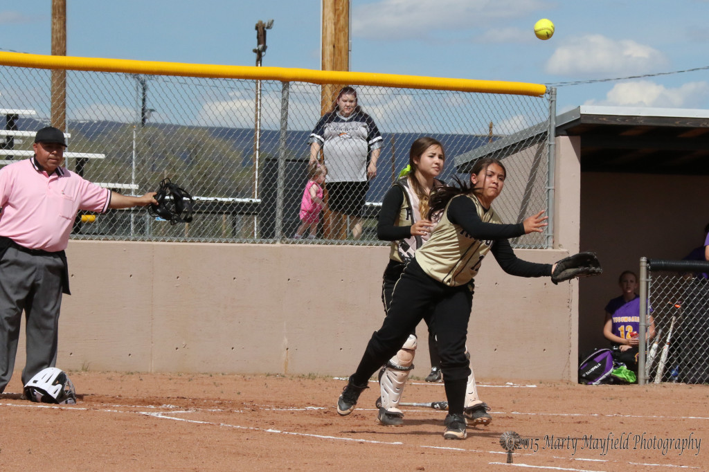 The Throw to first base by Andie Ortega