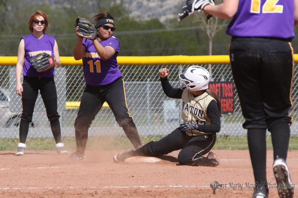 Andie Ortega makes it to third base well ahead of the ball