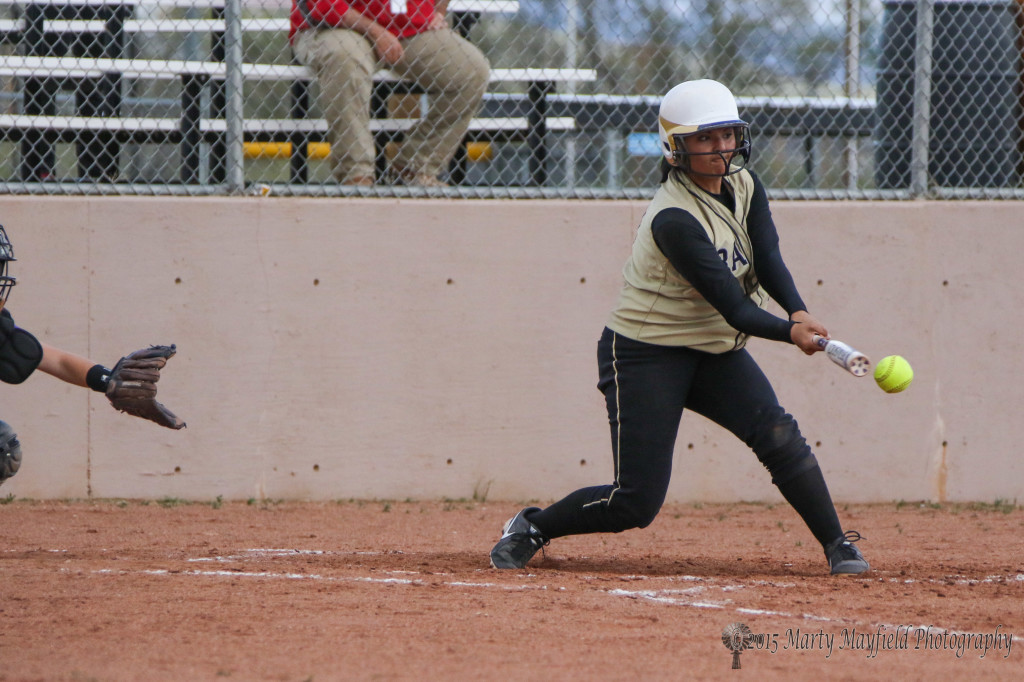 Natausha Archuleta makes contact and brings another run in on the way to a 15-0 win over Tucumcari