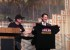 Billy Donati of the Shuler Restoration Board gives a Shuler 100th Anniversary t-shirt to Cabinet Secretary Jon Barela.