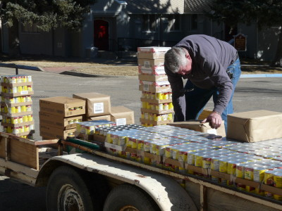 John Hudson is unloading food from the flatbed trailer.