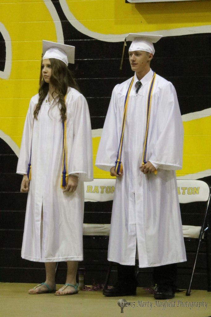 Kristina Jansen Valedictorian and Ethan Washburn Salutatorian await the presentation of their special honors at the Raton High Graduation ceremony Friday evening in Tiger Gym.