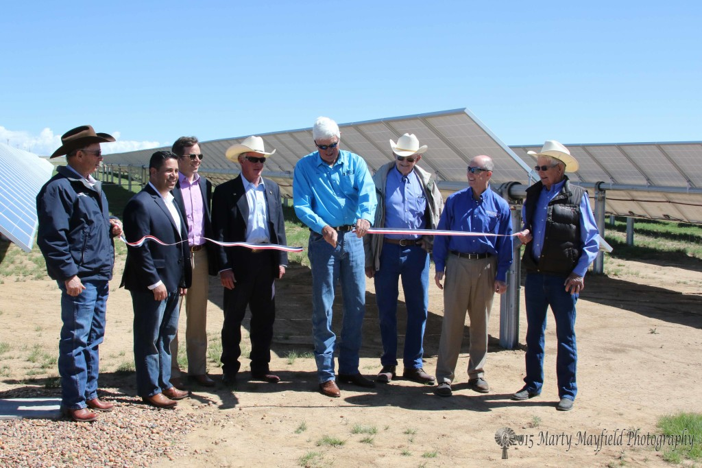 Springer Electric Board President cut the ribbon on the solar project not with scissors but with a cowboy's handiest tool, a pocket knife. SPEC Board Member Tim Morrow, Congressman Ben Ray Lujan, Terry Brunner USDA Rural Development Director, Pat Lyons, Public Regulation Commission, SPEC Board President Don Schutz, SPEC Board Member Bob Gillespie, David Spradlin Springer Electric Coop General Manager, SPEC Board Member Jerry Seward