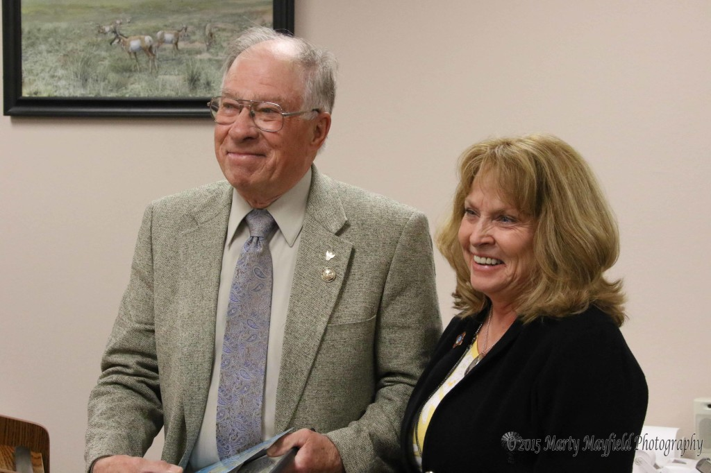Commissioner Linde Shuster present Robert Walton with the very first You Rock award for his work around town.