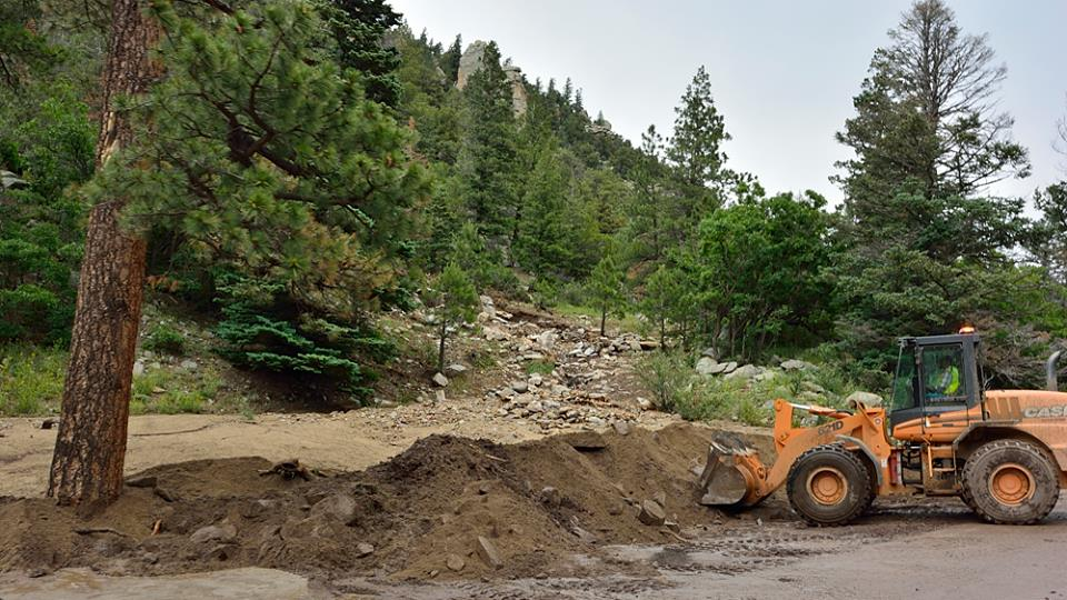 NMDOt is cleaning up the debris after major flooding in Cimarron Canyon    Photo by David Wettling