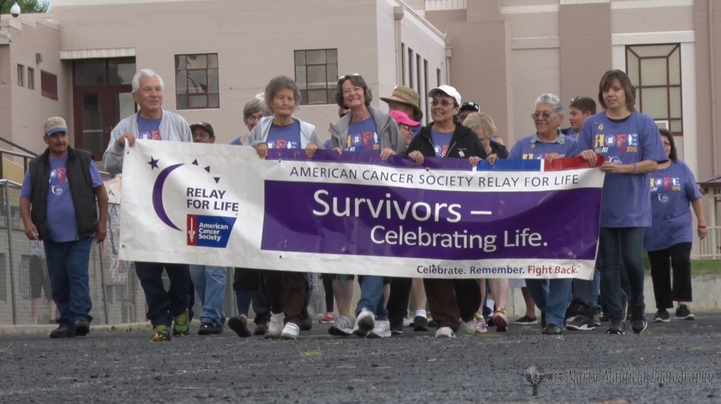 Survivors celebrate as they begin the survivor's lap at the 2015 Relay for Life event