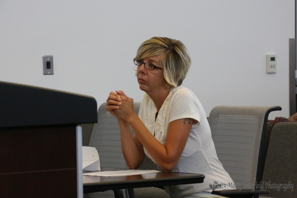 Marcia Rubio representing the Citizens of Raton group that filed the recall justification petition listens to Judge Paternoster's remarks regarding the petitions.
