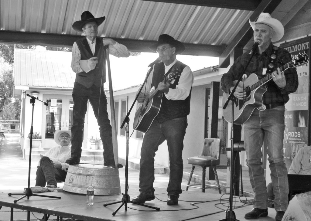 Several hundred folks had a heckuva good time listening to cowboy poetry and music in Cimarron last weekend.  Several of the performers are pictured above:  next to stage Dale Page, on stage Washtub Jerry, Randy Huston, and Jim Jones.  Photo by Sherry Goodyear.