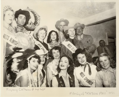 Miss Raton Pass and beauty queens from cities in New Mexico and Colorado: Front Row, Left to Right: Miss Trinidad, Marie Battu; Miss Raton Pass, Mary Gayle Hennigan (Baker); Miss Las Vegas, De Lynn Thomas; Dorothy Hart, Miss Springer, Wanda Jean Litten; Miss Des Moines, Dianne Nicholson Back Row, Left to Right: Miss Alamosa, Barbara Still; Steve Cochran; Miss Cimarron, Marilyn Ward (Decker); Miss Taos, Porfiria Valerio; Pope Gossett; Miss Clayton, Ann Butt; John Wright