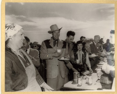 Food line at the barbeque on Raton Pass, held on the site of the present day Port of Entry Left to right: Mary Moore, Dennis Morgan, Dorothy Hart