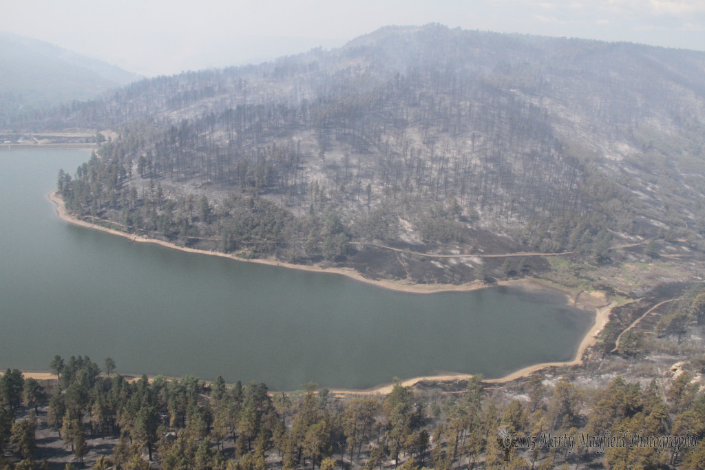 The smoke lingers after the 2011 Track Fire devastated the watershed around Lake Maloya