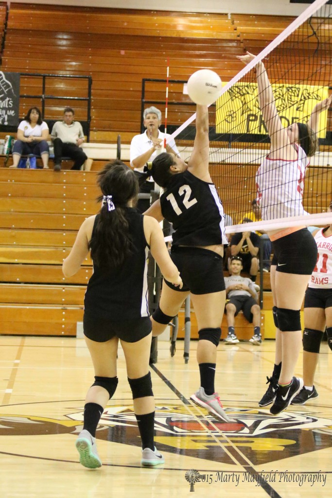 Rebecca Muniz put the ball up but Caitlyn Jeide was there to put it right back down for the Cimarron point.