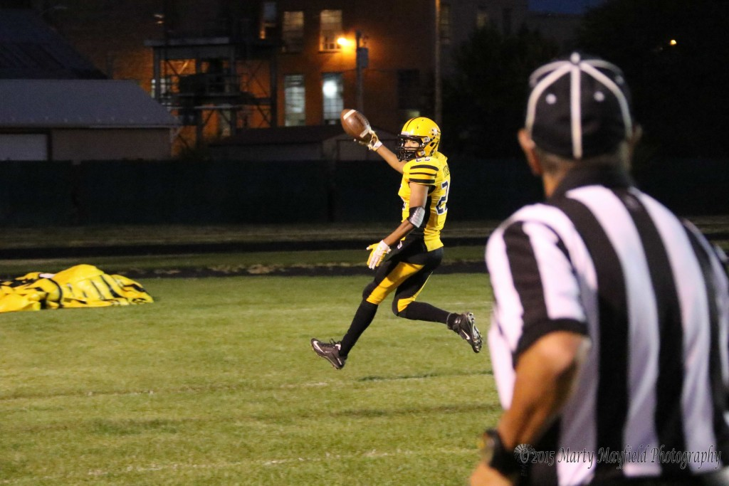 Jonathan Cabriales holds the ball up as he crosses the goal line, one of his four tds of the homecoming night.