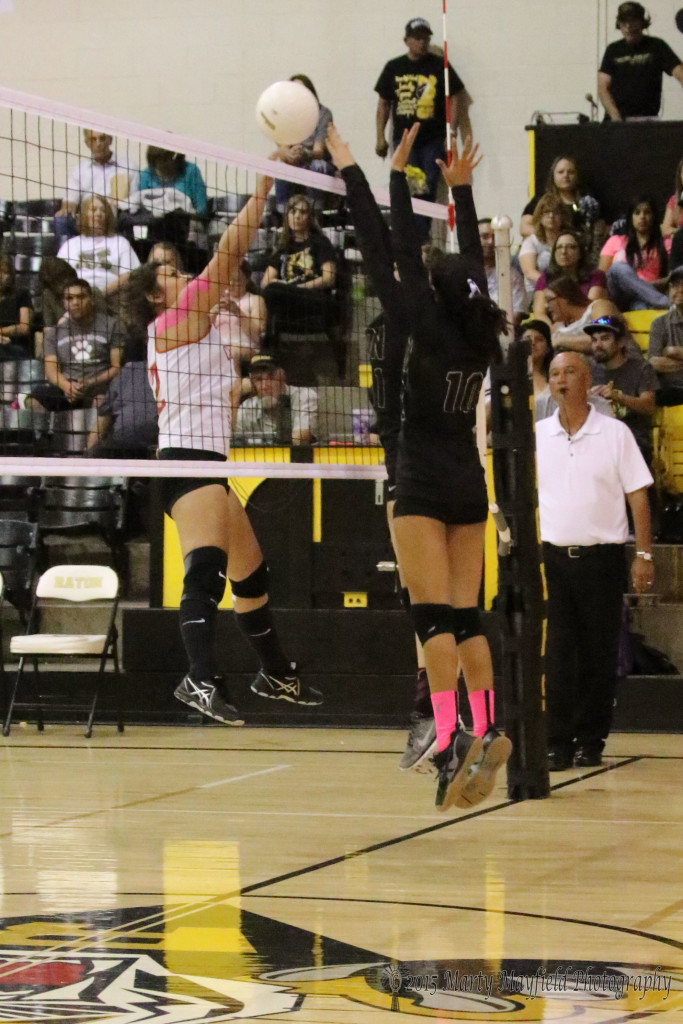 Mariah Martinez makes the hit over the net as Camryn Mileta and Autumn Archuleta go for the block.
