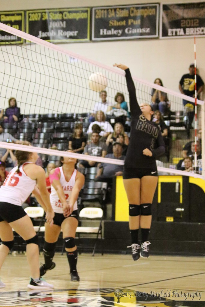 Sophia Maddaleni puts the ball back down as Mariah Martinez and Jaylyn Ratliff prepare to make the pass.
