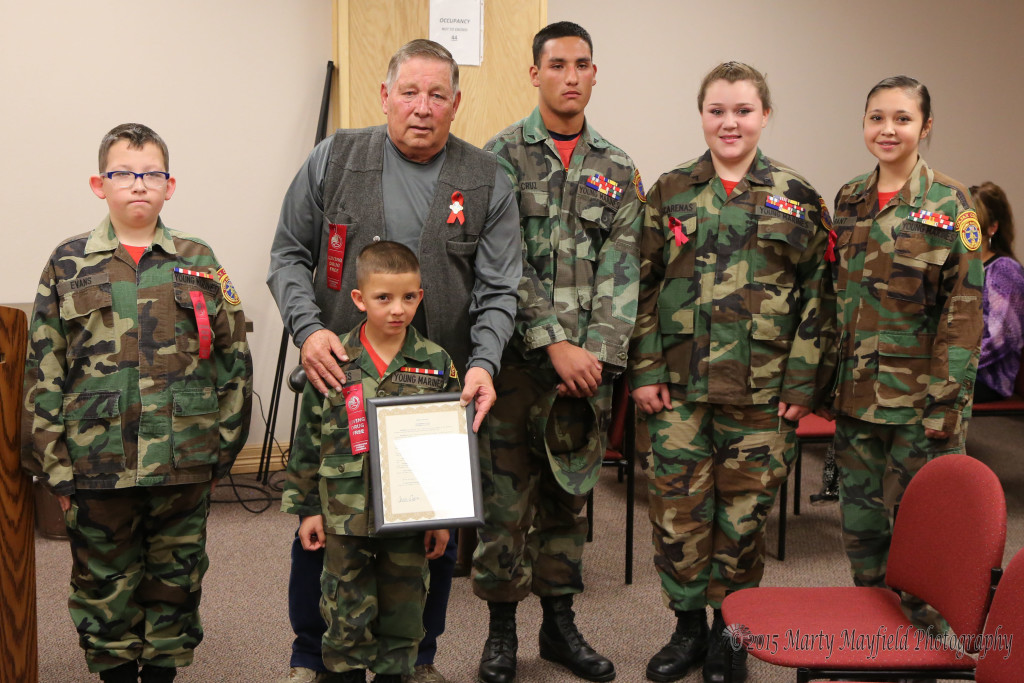 Private Shane Evans, Private Abenecio Maes, Lance Corporal Aaron Cruz, Lance Corporal Jimmie Mascara's and PFC Claire Durant accept the proclamation from Commissioner Ron Chavez for Red Ribbon week to promote a drug free environment.