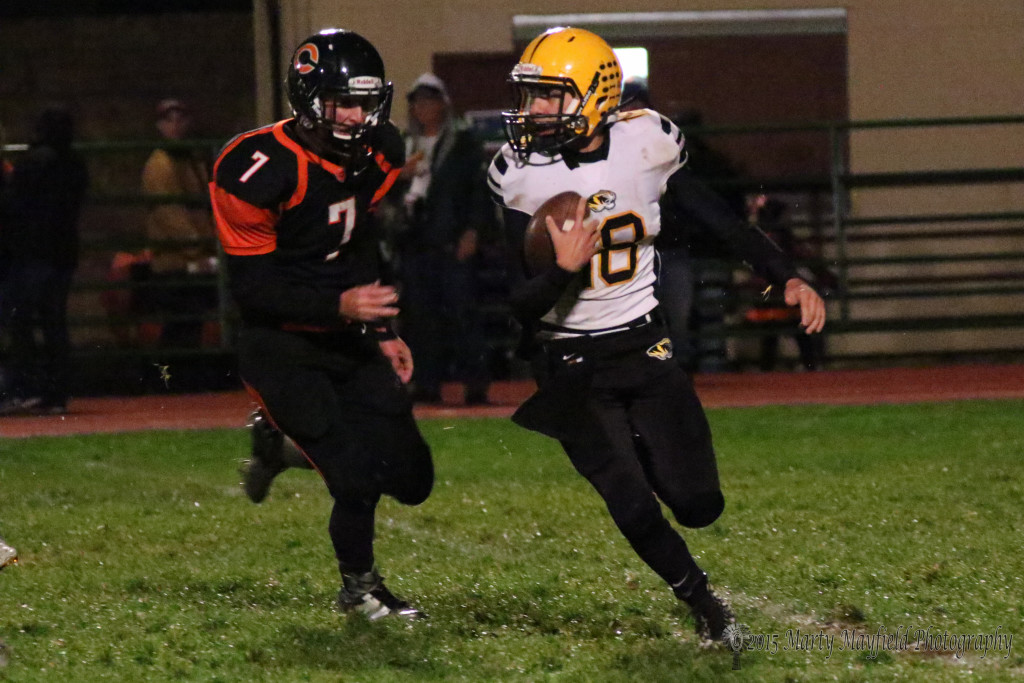 As was the case a lot in the game Raton QB Dustin Segura was running with a Yellowjacket hot on his tail.