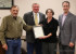 Commissioner Don Giacomo presents the Miner's Day proclamation to Scott Berry, Kathy McQuery and Shawn Lerch