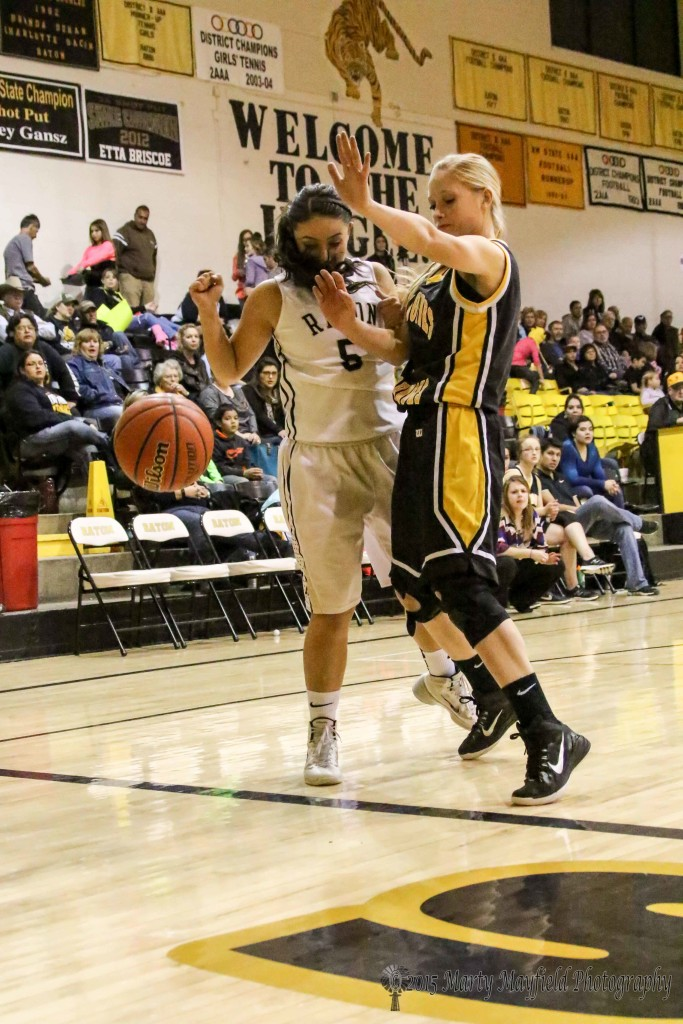MaKenna Hittson and Sophia Maddaleni watch the ball go out of bounds as they tangle on the line.
